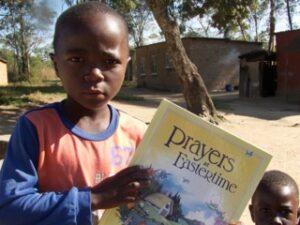 IMIRE COMMUNITY CHILDREN RECEIVING BOOKS