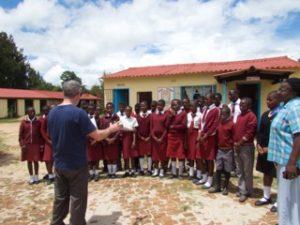 Schoolchildren gathered to receive computer donation